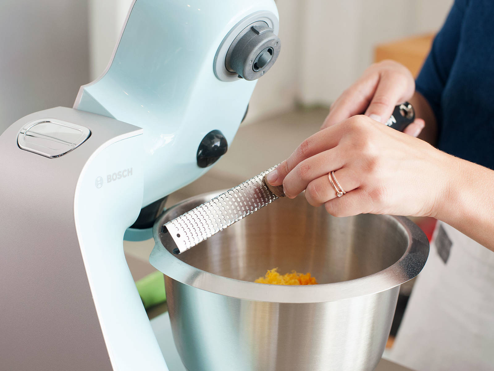 Add flour, remaining sugar, salt, citrus zests, vanilla bean seeds, and nutmeg to bowl of a stand mixer. Stir until combined.
