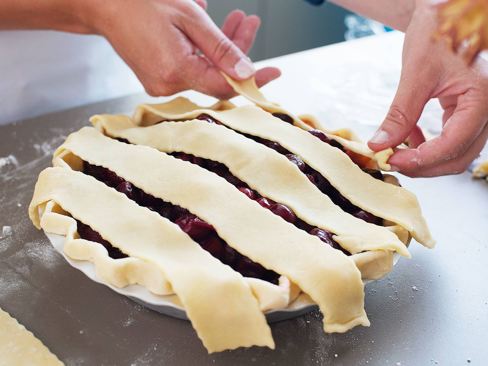 Roll second dough disk into a round of same thickness and cut into 1-in./2.5-cm wide strips. Use the strips to form a lattice pattern over the cherry filling.