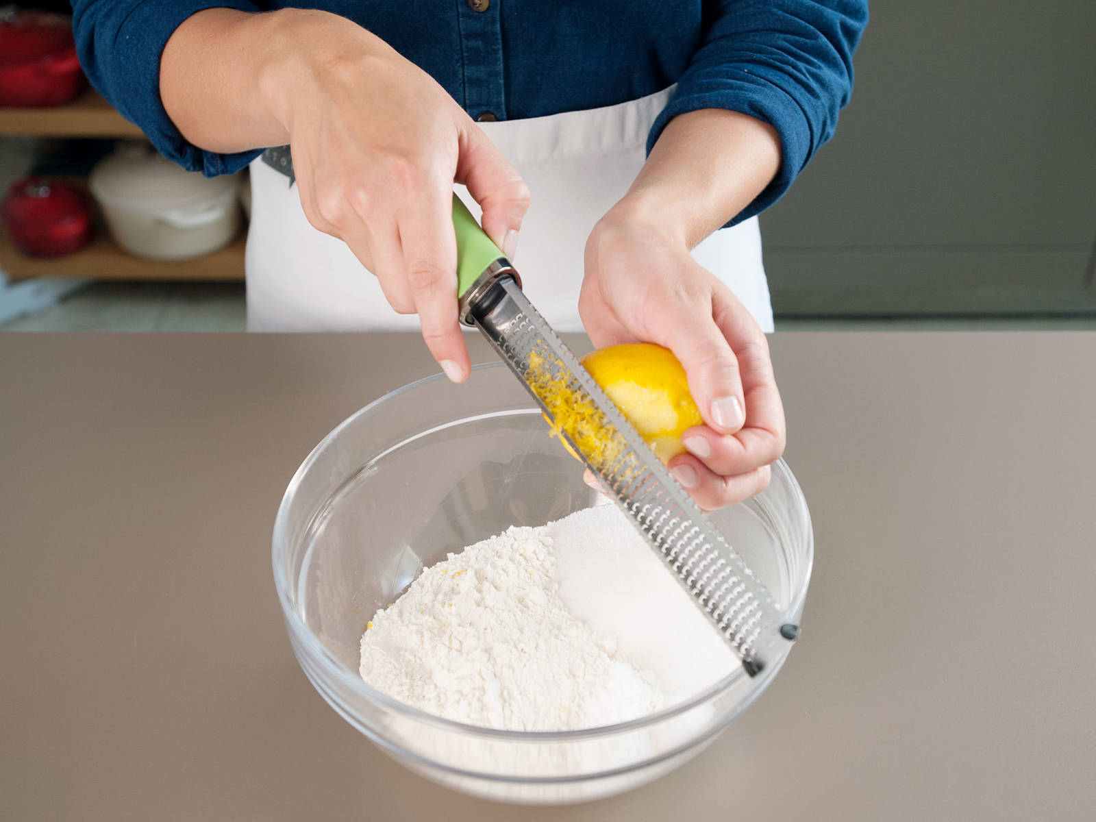 Preheat oven to 175°C/350°F. In a large bowl, combine flour, sugar, baking powder, salt, and lemon zest.