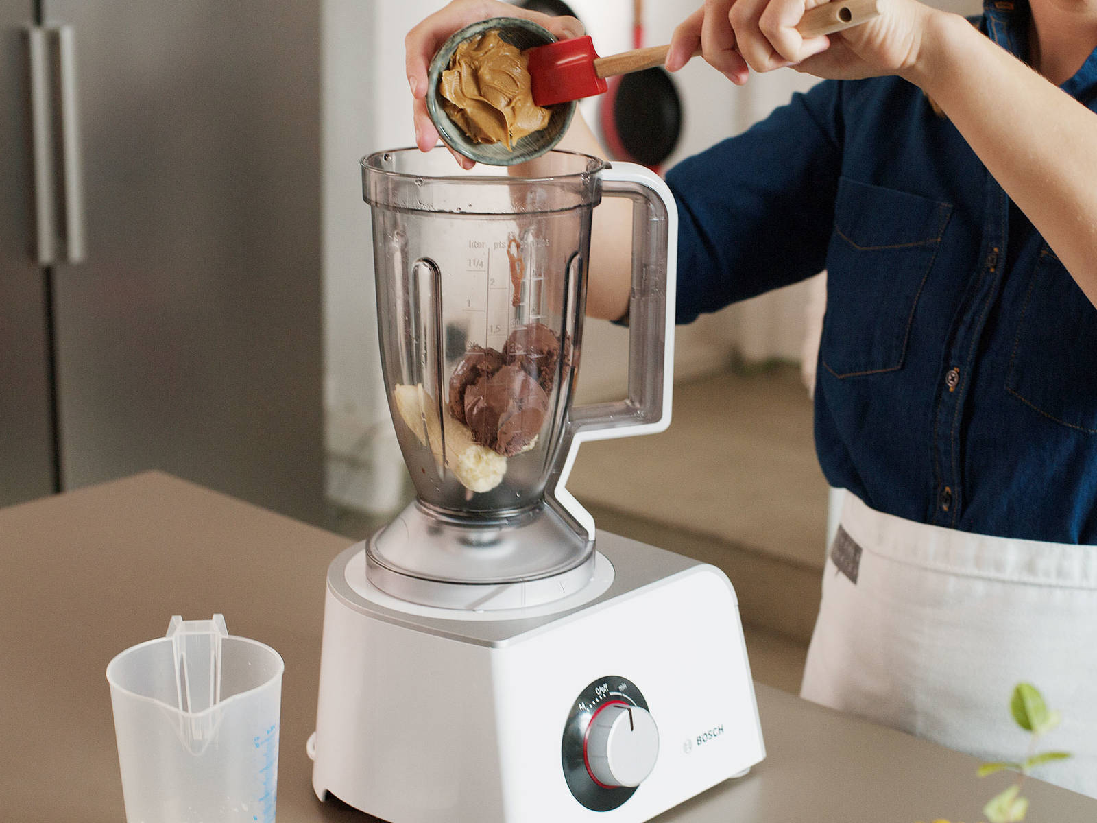 Combine ice cream, milk, peanut butter, banana, and salt in a blender.