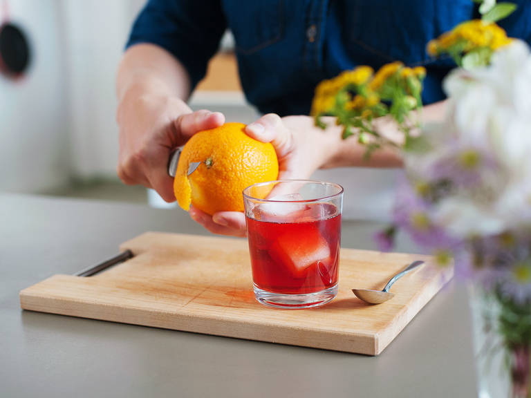 Cut an orange peel, rub it gently around the rim of glass, then use it as garnish. Enjoy!