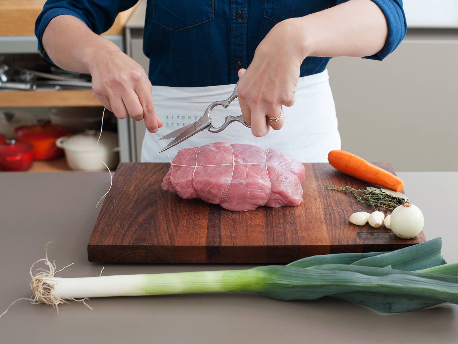 Trim excess fat from the veal and truss it with cooking string. Roughly chop celery, carrot, onion, and leek
