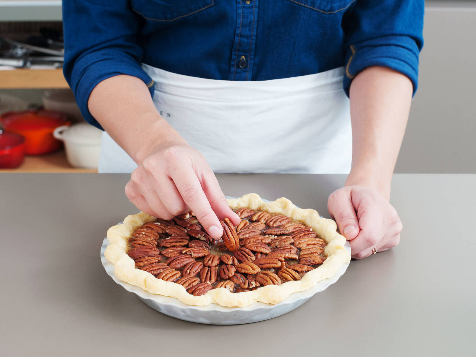 If desired, garnish the top of the pie with more pecans, arranged in concentric circles, for a more refined look. Turn oven temperature down to 175°C/350°F and bake pie for approx. 45 – 55 min., or until the filling is firm to the touch but still jiggles slightly. Let cool to room temperature before serving. Serve with vanilla ice cream or whipped cream. Enjoy!