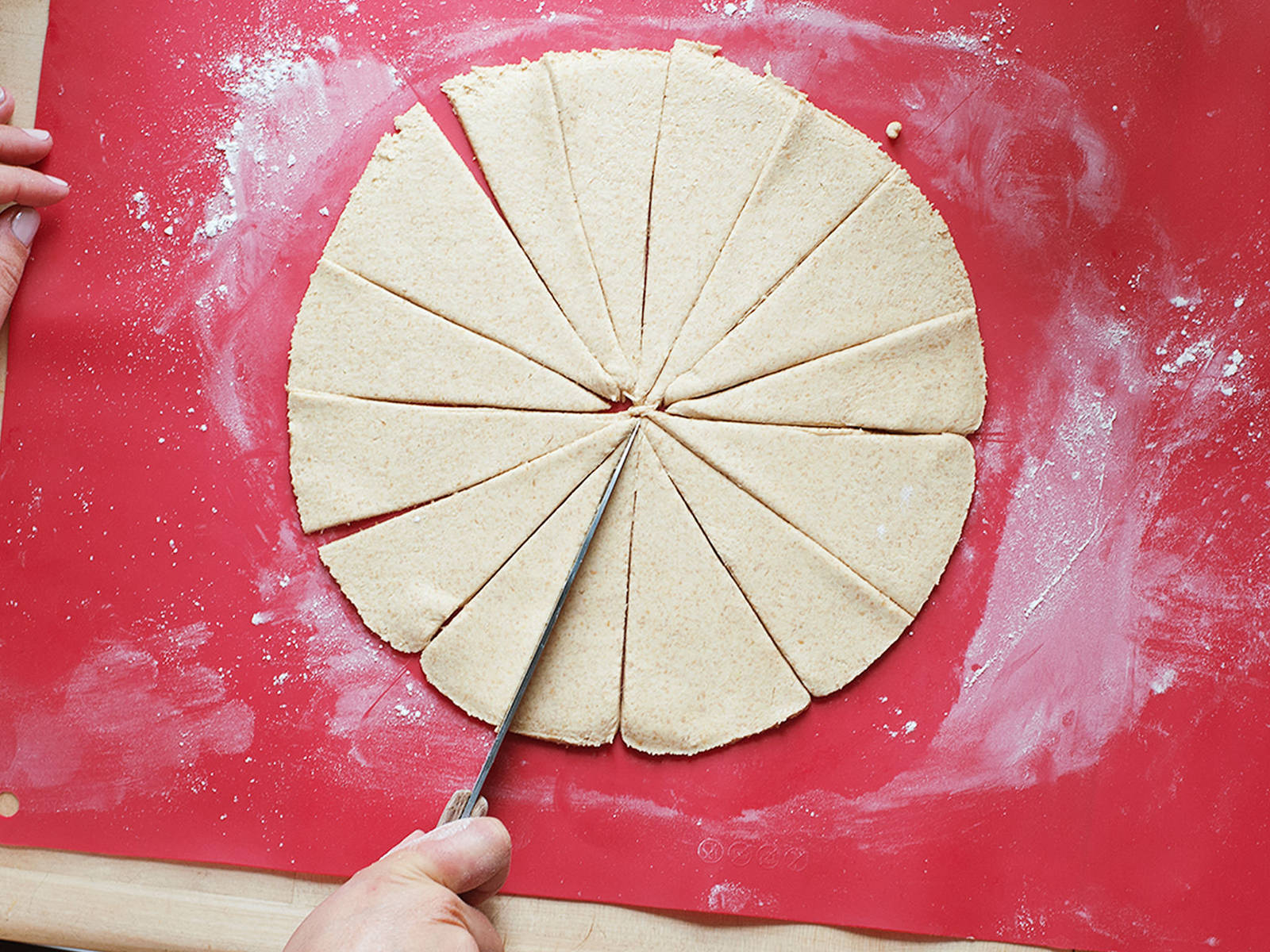 On a floured surface, roll out dough into a round (approx. 26 cm/10 in.). If necessary, use a plate as a guide and add flour for dusting. Cut dough into 16 equal triangles.
