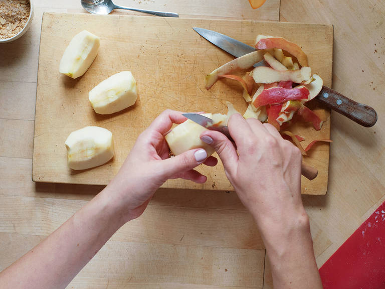 Peel, core, and slice apple. Spread some of the almond-cinnamon mixture over the dough triangles. Place an apple slice on the outer part of each piece of dough.