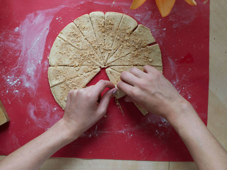 Roll up the pieces of dough from the outside in, wrapping the apple slices inside.