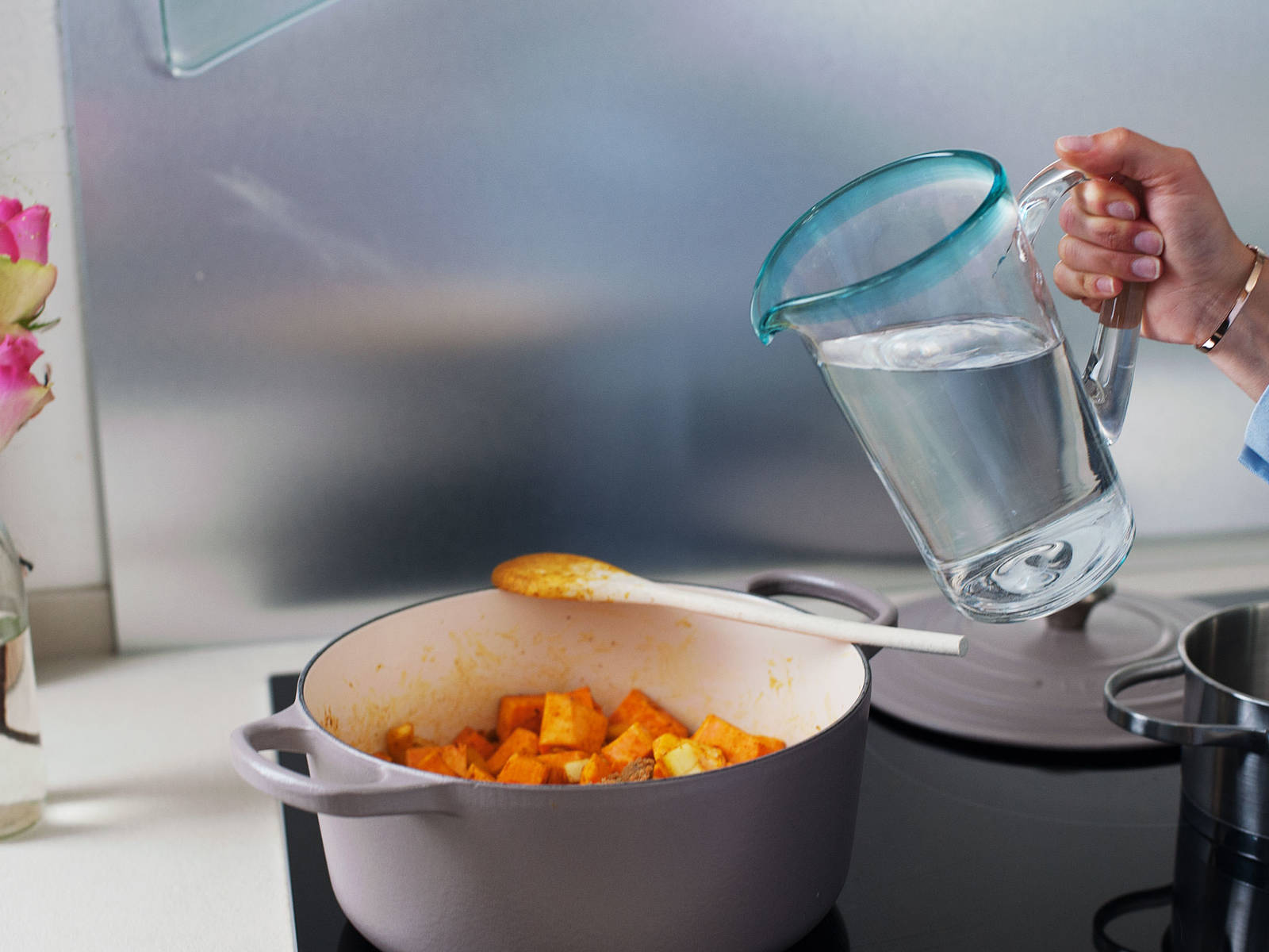 Stir in water, vegetable stock, and tomatoes and bring to a boil. Reduce heat and let simmer for approx. 15 – 20 min. until sweet potatoes are softened, but still firm.