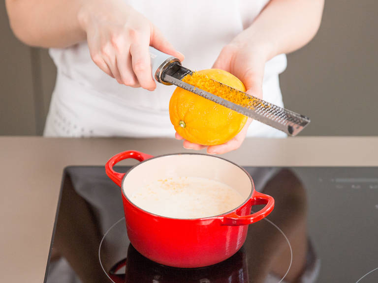Add the remaining cream, milk, vanilla bean seeds, and orange zest to a small saucepan. Bring to a boil over medium-low heat and then leave it to cool for approx. 5 – 10 min.