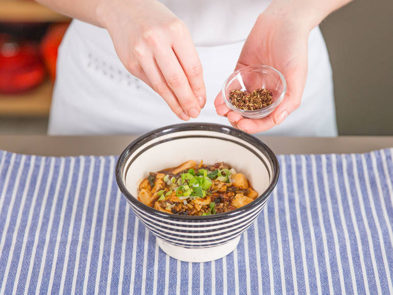 Transfer to a plate, season to taste with Sichuan pepper powder, and green onion. Enjoy!