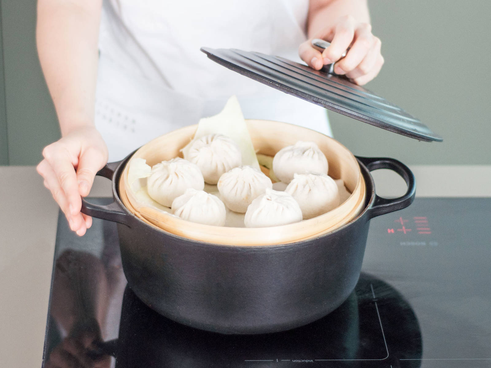 Transfer buns to a steam basket set over boiling water and steam for approx. 15 min.  Allow to cool and enjoy!