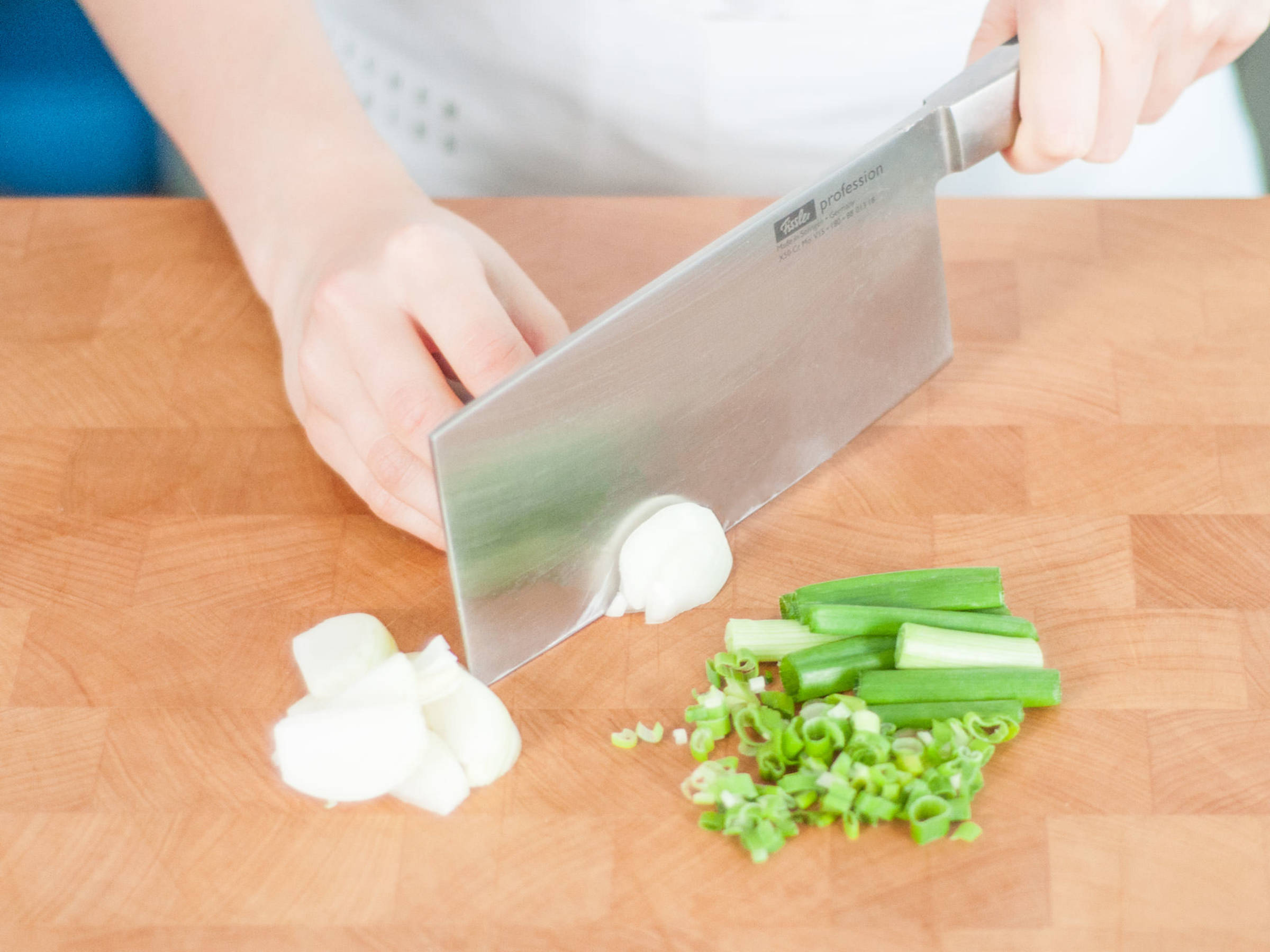 Halve the white tops of half of the scallions lengthwise, then roughly chop them; finely chop remaining scallions. Julienne the onion.