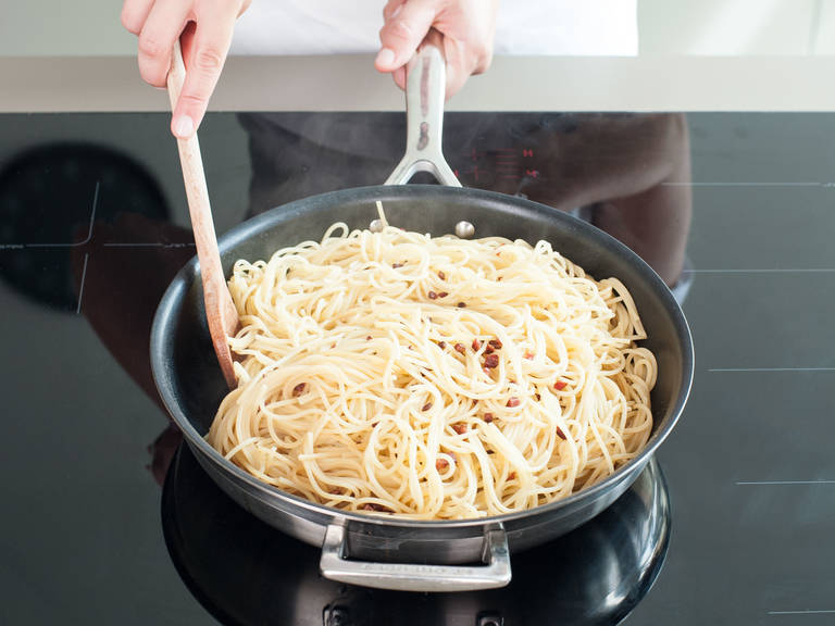 Toss pasta in skillet with pancetta until it's coated in its fat.