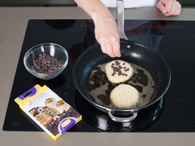 Heat pan over medium heat and add enough butter to coat well. Pour batter onto pan in small circles; if using, sprinkle with chocolate chips. Cook until their tops bubble and bottoms turn golden brown, approx. 1 – 2 min. Flip pancake and cook for approx. 30 more sec. If needed, add more butter and adjust heat as you go to prevent sticking or burning. Serve immediately. Enjoy with more butter and a drizzle of maple syrup.