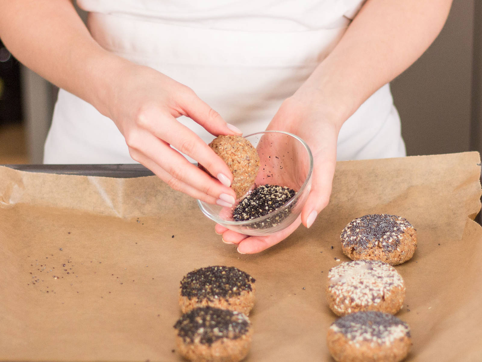 Form dough into balls and transfer to a parchment-lined baking sheet. Roll balls in black sesame, white sesame, or poppy seeds. Bake at 180°C/350°F for approx. 20 – 30 min. Enjoy!