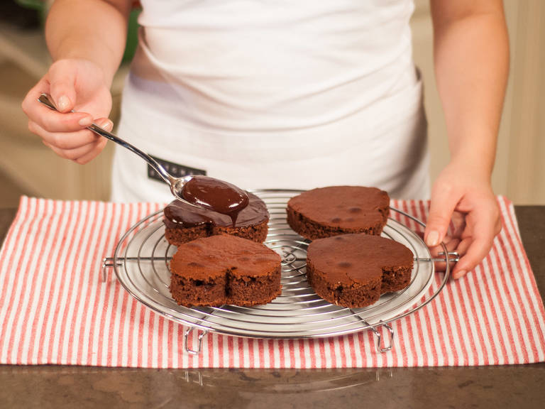 Place a plate underneath a cake rack to catch any excess ganache. Using a brush, spread ganache over the top of the cookies. Allow to set. Enjoy with your loved ones.