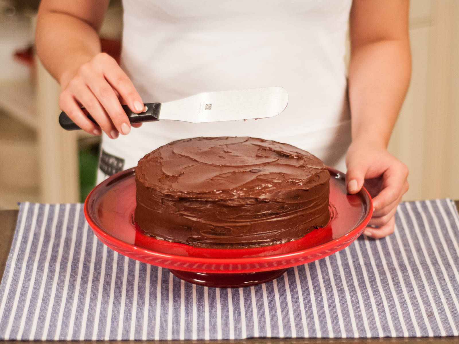 Place the second cake base on top and cover the whole cake with remaining chocolate ganache. Serve with a cup of coffee or tea.