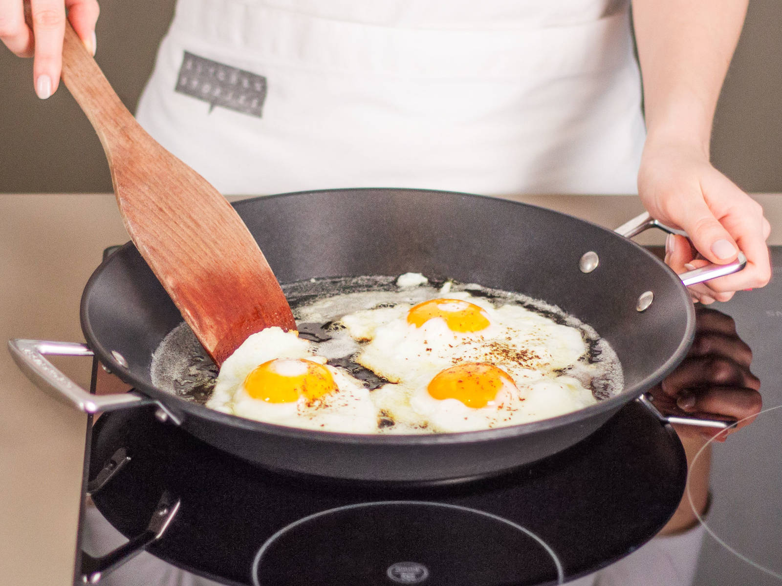 In a separate large frying pan, fry eggs in some vegetable oil over medium heat for approx. 2 – 4 min. until whites are opaque and yolks begin to set. Then, transfer fried eggs to pan with meatballs. Enjoy with a side of our signature hot chili sauce!
