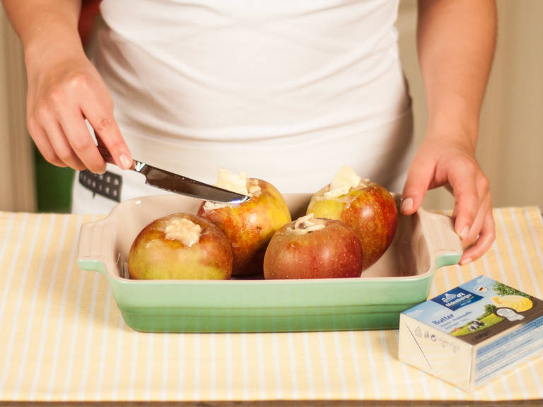 Place apples in a casserole dish. Dot the apples with butter.