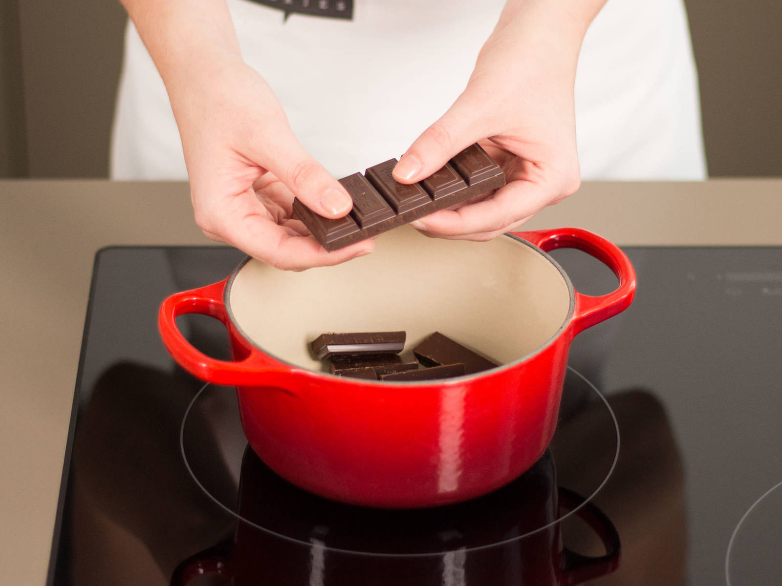 Add chocolate to a small saucepan and melt over low heat.