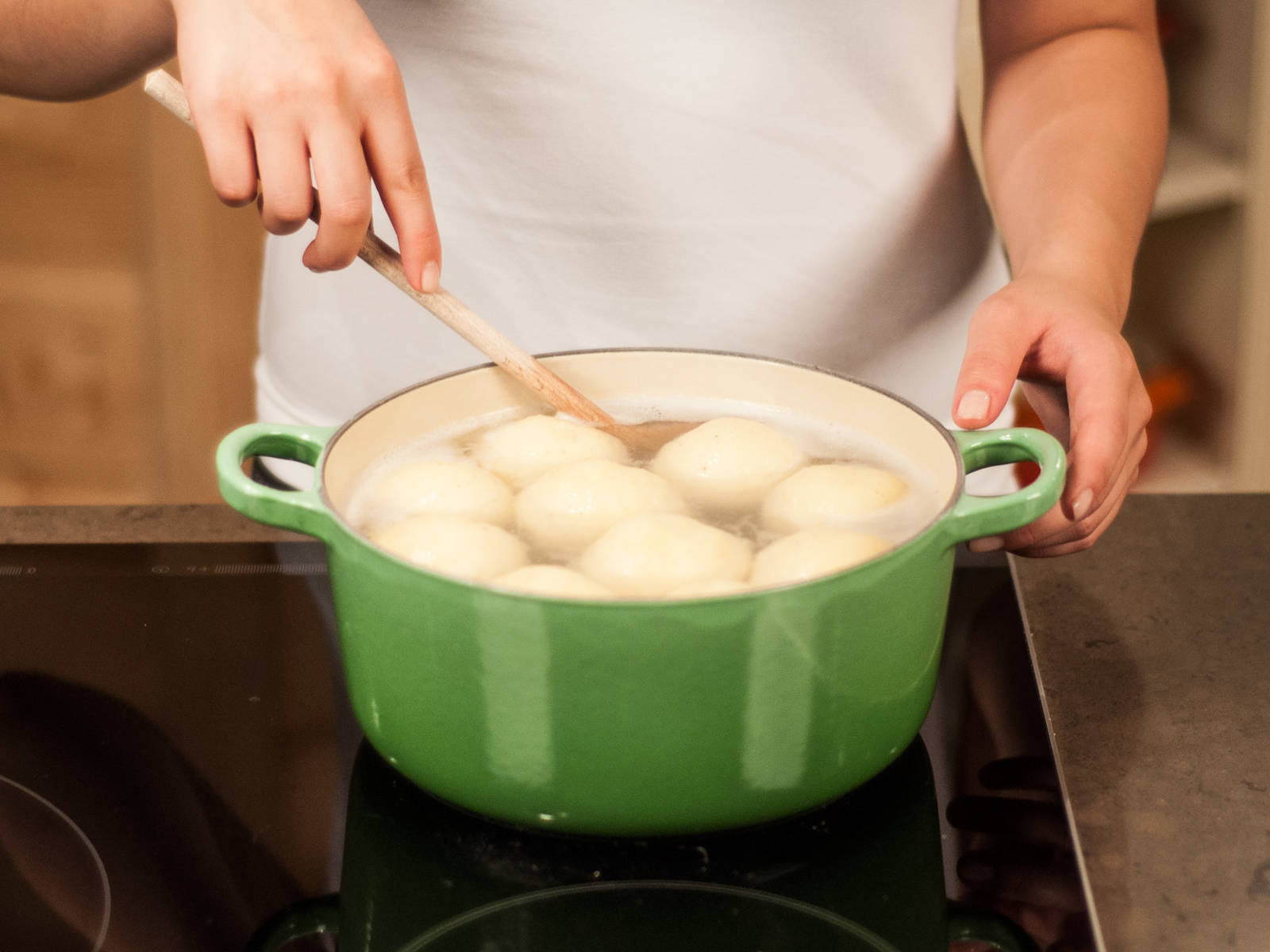 Bring a large pot of lightly salted water to a boil. Carefully drop dumplings into water and reduce heat. Allow to steep for approx. 20 – 30 min. until dumplings are floating. Then, carefully remove from water with a skimmer.