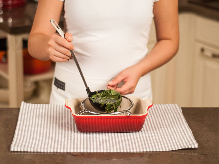 Place sieve inside of a casserole dish. Pour basil-tarragon syrup through the sieve and remove wilted herbs. Transfer granita to freezer and allow to set for approx. 5 – 6  hours.