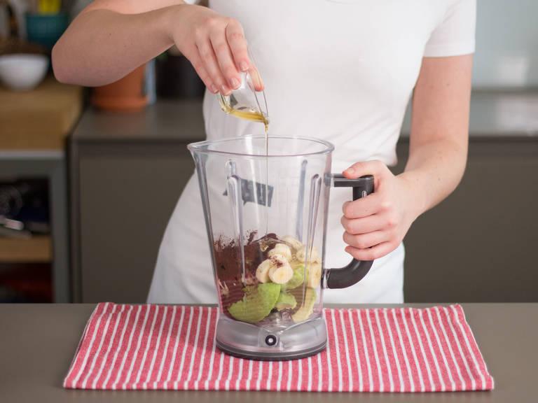 Add avocado, banana, vanilla bean seeds, cocoa powder, and agave nectar to a blender.