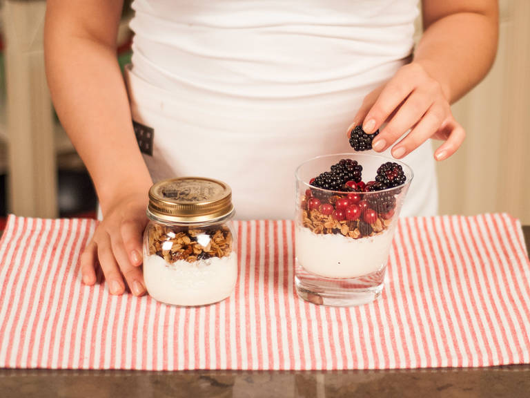 In a glass, layer the yogurt and the granola. Top with berries. Serve with more maple syrup and cinnamon for a sweeter flavor. Enjoy!