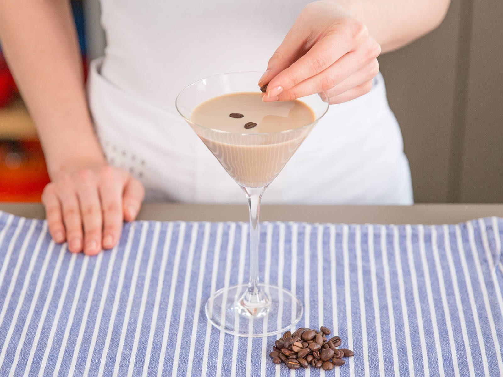 Pour into a martini glass for serving. Garnish with whole coffee beans. Enjoy!