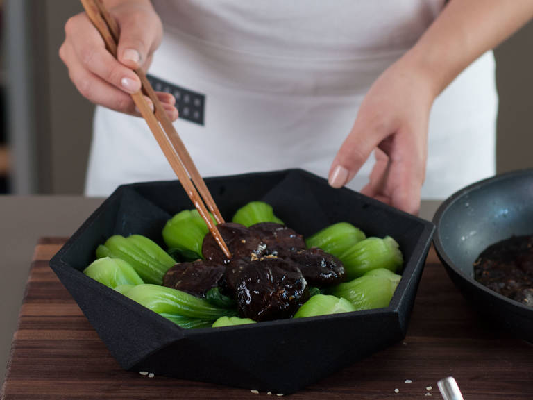 Arrange bok choy in a bowl for serving. Place the shiitake mushrooms in the center. Garnish with sauce. Enjoy!
