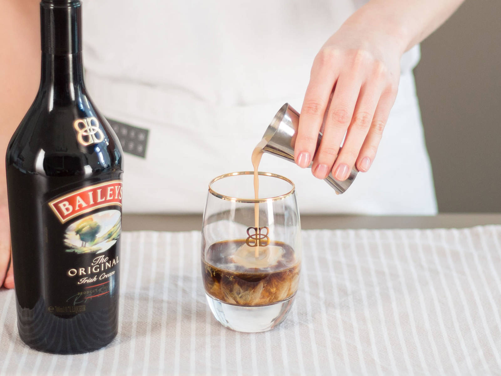 Pour coffee into glasses for serving and add Baileys. Stir well. Enjoy on ice!