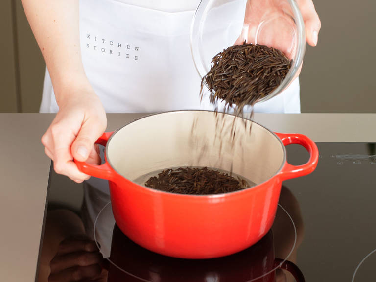 In a small saucepan, bring wild rice to a boil in salted boiling water, reduce heat to low, cover, and cook according to package instructions for approx. 35 – 40 min. Remove from heat and set aside.