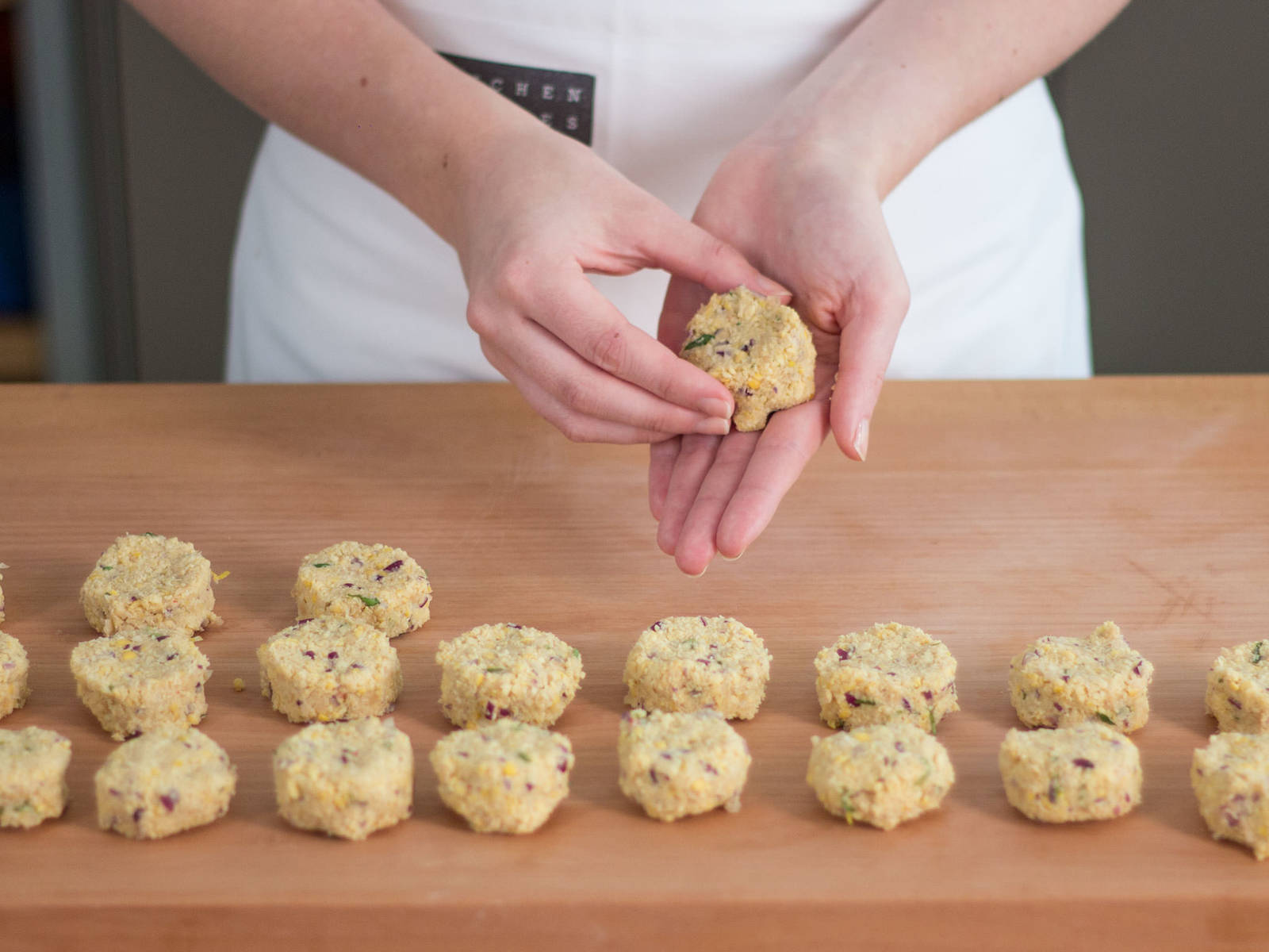 Using your hands, form mixture into small disc-shaped patties.