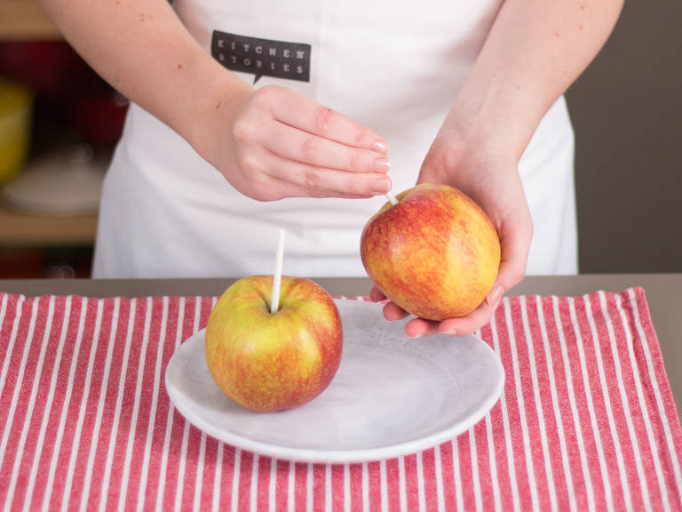 Press a thick wooden skewer into the center of each apple and place in freezer for approx. 1 hr.