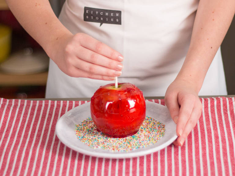 Dip apples into sprinkles, as desired. Transfer to a parchment paper-lined baking sheet and allow to cool. Enjoy!