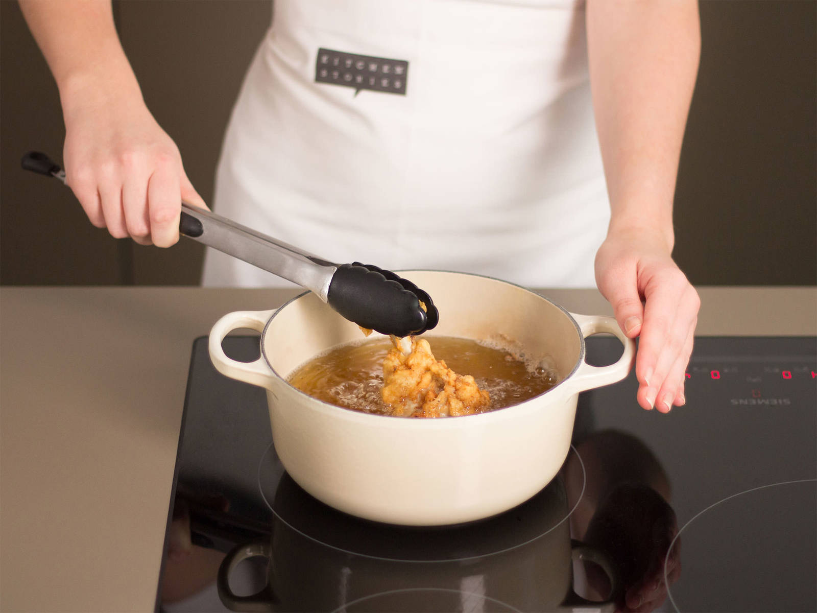 Preheat frying oil over medium-high heat in a large, deep frying pan. The right temperature is reached when small bubbles form when a wooden spoon is held into the oil. Fry chicken pieces in batches until brown and crispy for approx. 3 - 5 min. Transfer to a lined baking sheet and bake in a preheated oven at 200°C/400°F for approx. 10 - 15 min. Remove from oven and enjoy with lemon wedges and dipping sauces of your choice!