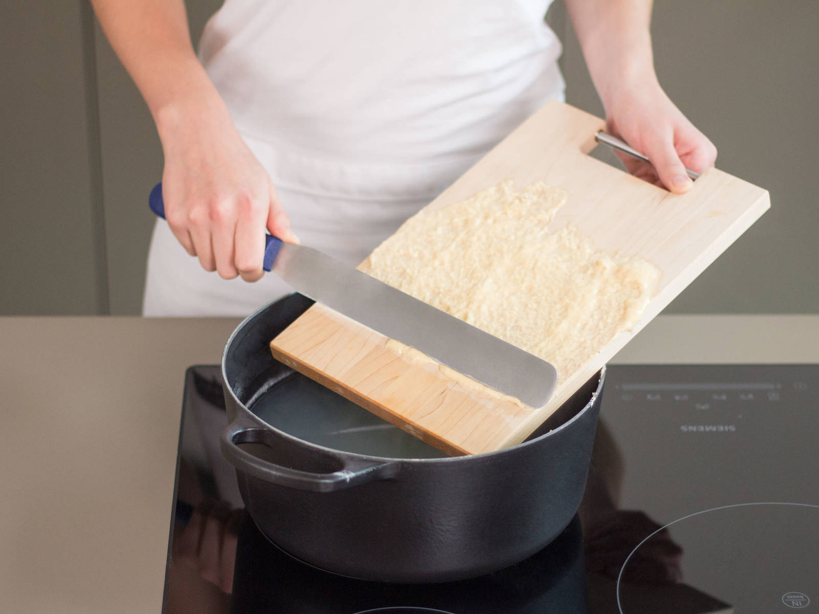 Fill a large saucepan half full with salted water and bring to a boil over medium-high heat. Next, wet cutting board with a little boiling water and then spread a thin, even layer of dough over a cutting board. Using a pastry spatula, shave off thin strips of dough, approx. the width of a pencil, into water. Cook for approx. 1 min. or until spätzle rises to the surface. Transfer to an ice bath for approx. 20 sec. to halt cooking process and then place in a colander to drain.