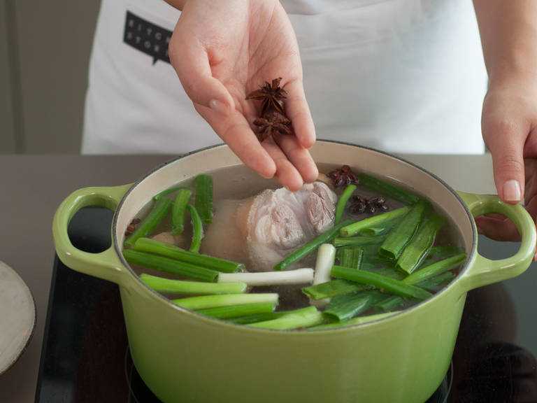 Add ginger, green onions, rock sugar, white wine, Sichuan peppercorns, and star anise to pan. Reduce heat to medium and cook for approx. 50 – 60 min. Then, add salt to pan and cook on low heat for approx. 30 – 40 min.