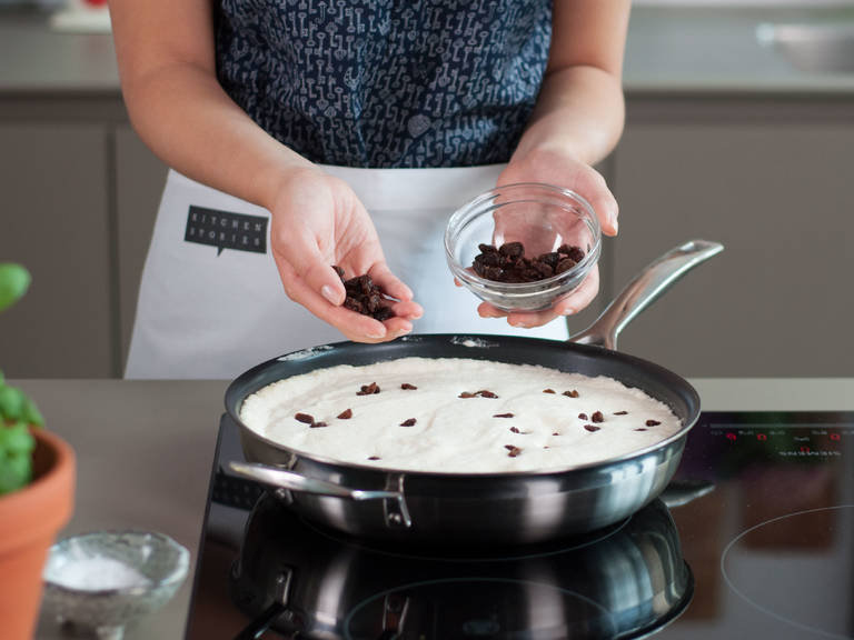 Melt butter in a frying pan over medium heat. Add batter to pan, sprinkle raisins on top, and cook for approx. 3 - 5 min. Transfer to preheated oven and bake at 220°C/425°F for approx. 10 - 15 min. until golden.
