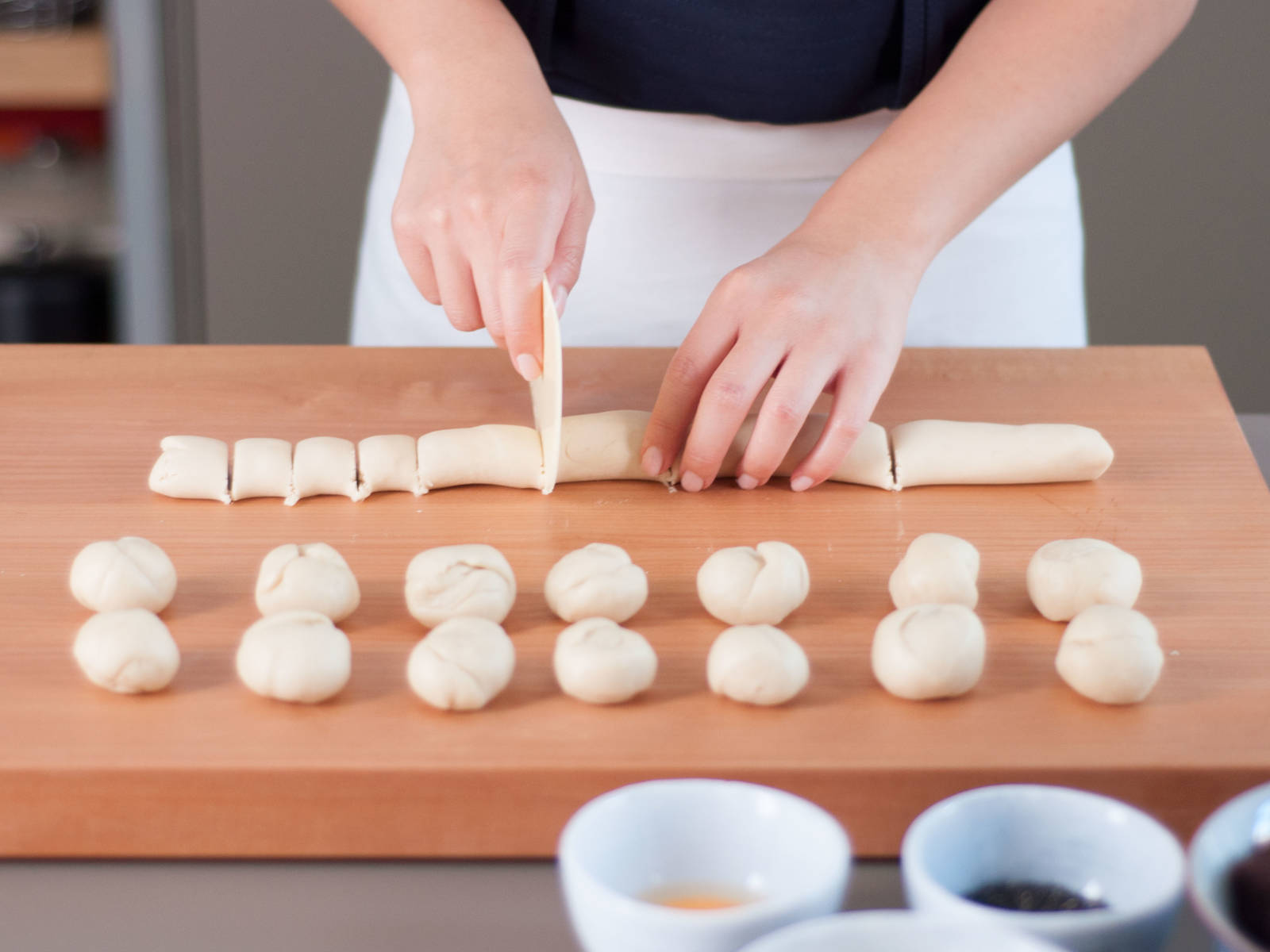 Preheat oven to 180°C/350°F. Roll each dough into a long strip approx. thumb thick. Cut first dough into equal portions approx. finger-width in length. Separate second dough into an equal number of portions. Roll each portion into a ball in the palm of your hand, keeping the two doughs separate.
