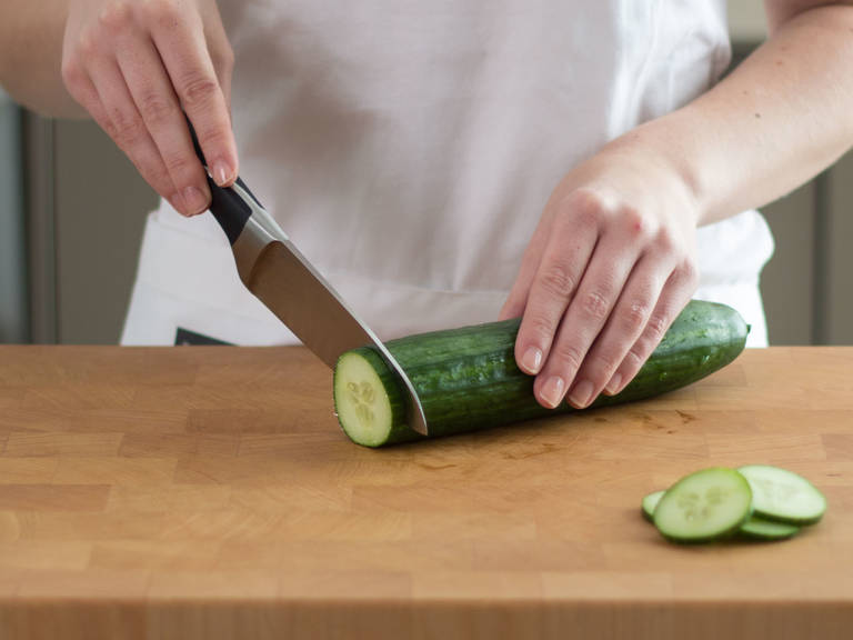Cut cucumber into slices.