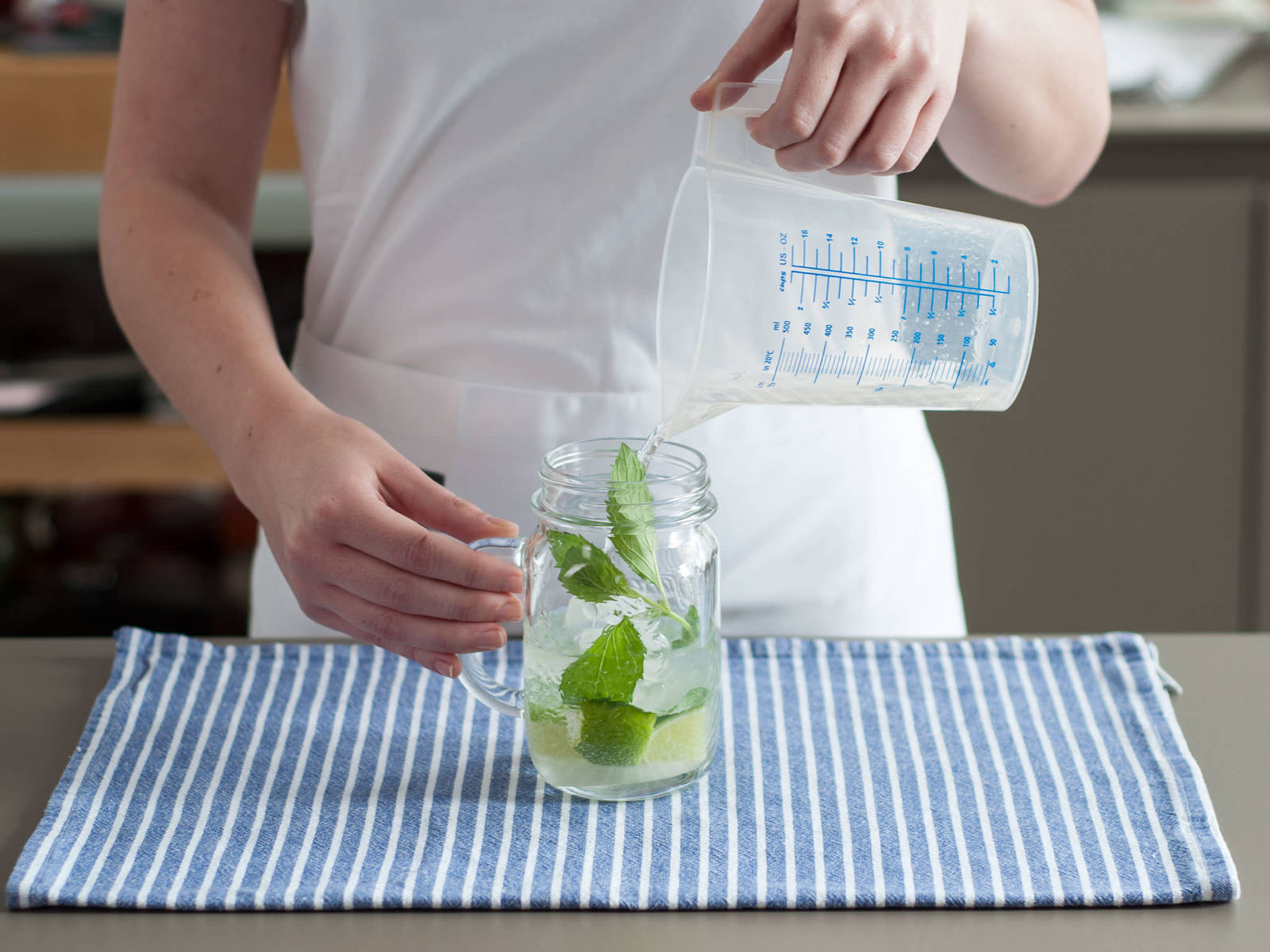 Add ice cubes to glass. Pour in rum and lightly stir. Top up with soda water. Garnish with mint and enjoy!