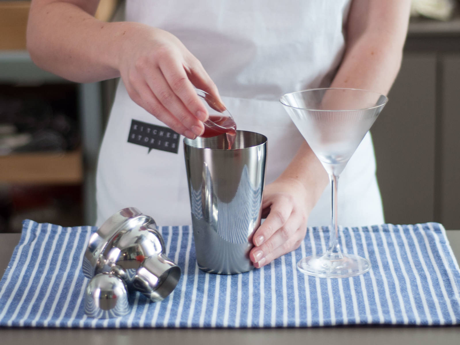 Briefly place martini glass in freezer until lightly frosted. In a cocktail shaker, add Cointreau, cranberry juice, lime juice, vodka, and ice cubes. Shake vigorously for approx. 30 sec.