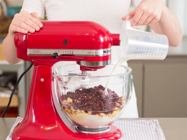 Add flour, baking powder, walnuts, cranberries, yogurt, eggs, salt, and milk to a stand mixer. Beat for approx. 2 – 3 min. until a smooth dough forms.
