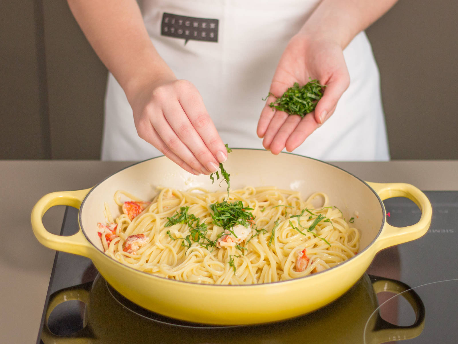 Add cooked pasta, a bit of pasta water, garlic, lemon juice, and basil to the lobster and stir to thoroughly combine. Season to taste with salt and pepper. Transfer to a plate for serving. Enjoy!