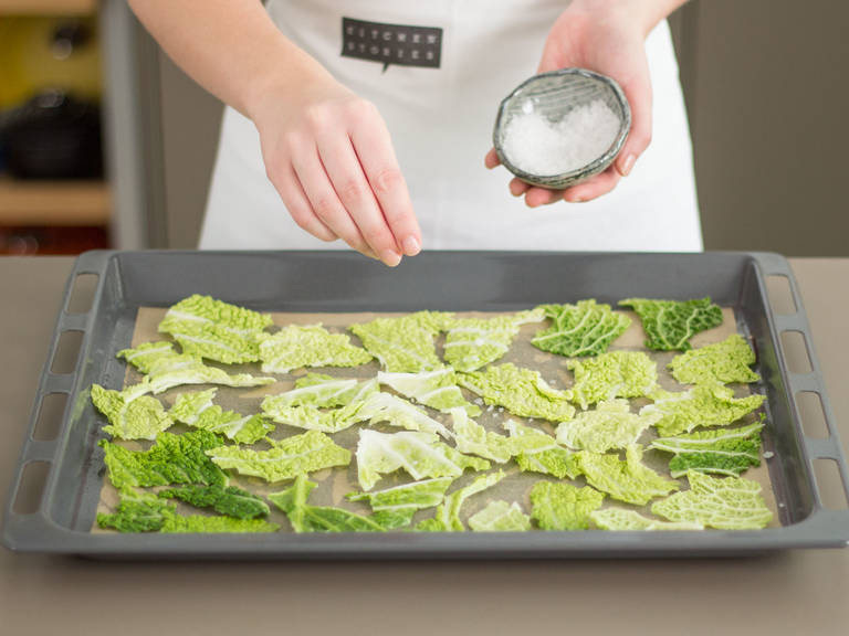Arrange cabbage on a parchment paper-lined baking sheet. Drizzle with vegetable oil. Sprinkle sea salt on top. Bake in preheated oven at 180°C/355°F for approx. 10 – 15 min. until crispy.