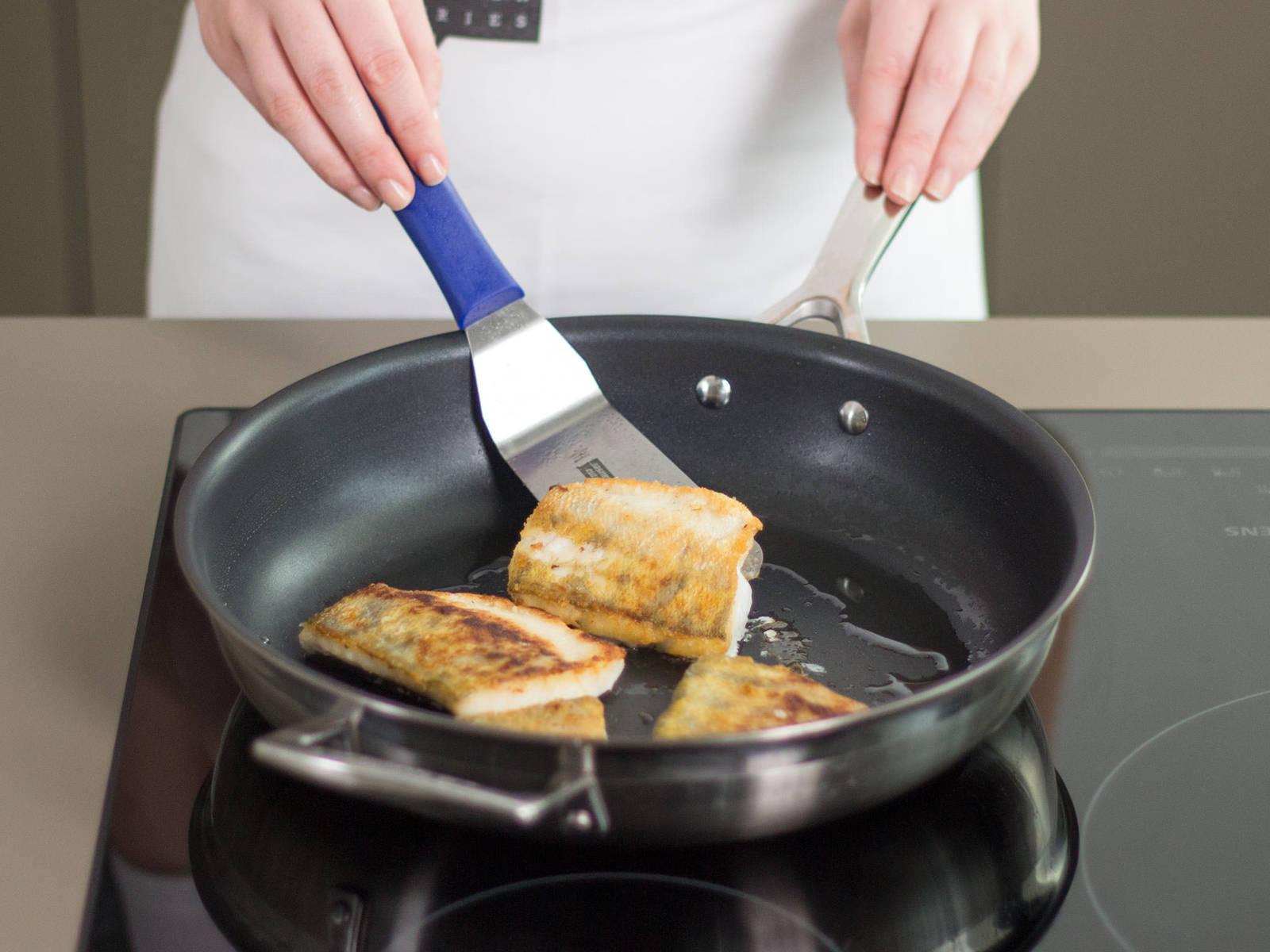 In a large frying pan, sauté perch in some vegetable oil over medium heat for approx. 1 – 3 min. per side. Season to taste with salt and pepper. Serve perch on a bed of sautéed cabbage and garnish with crispy cabbage leaves. Enjoy!