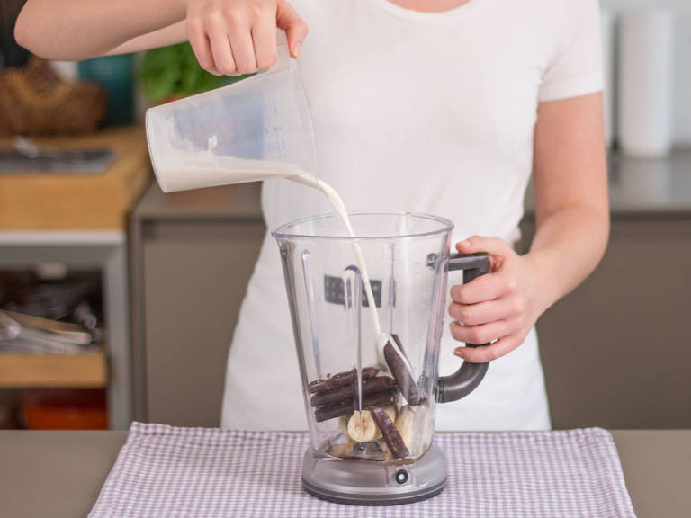 Add acai puree, remainder of bananas, maple syrup, and almond milk to a blender and blend on high speed for approx. 1 – 2 min. until a smooth, pudding-like consistency is achieved.