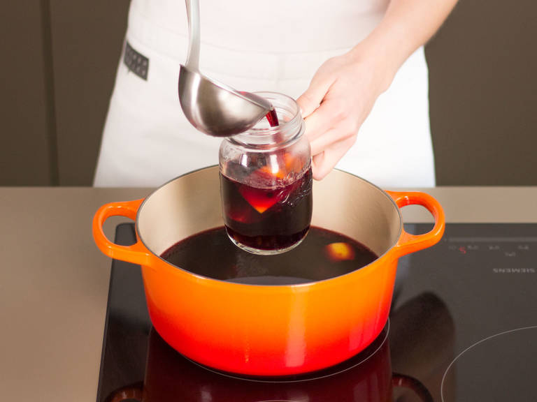 Remove spices from mulled wine if desired. Serve hot.