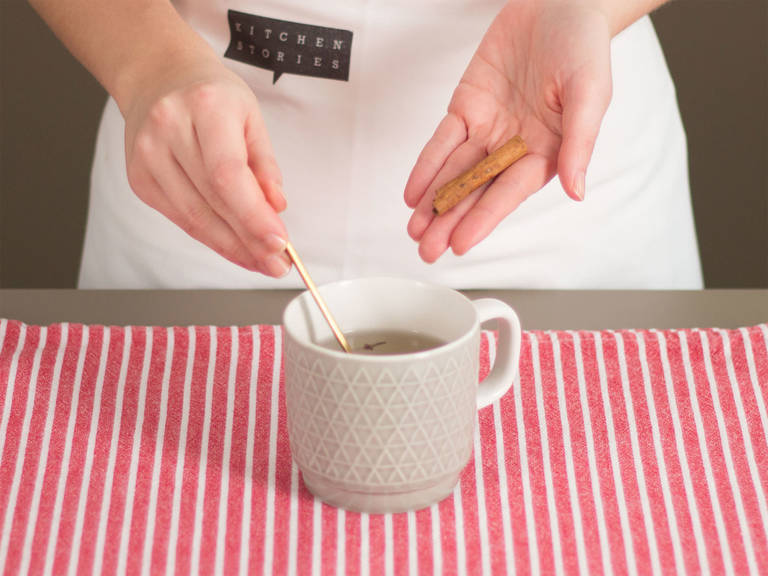 Pour hot water into a mug. Add honey, cloves, and cinnamon stick. Allow to cool for approx. 2 – 3 min.