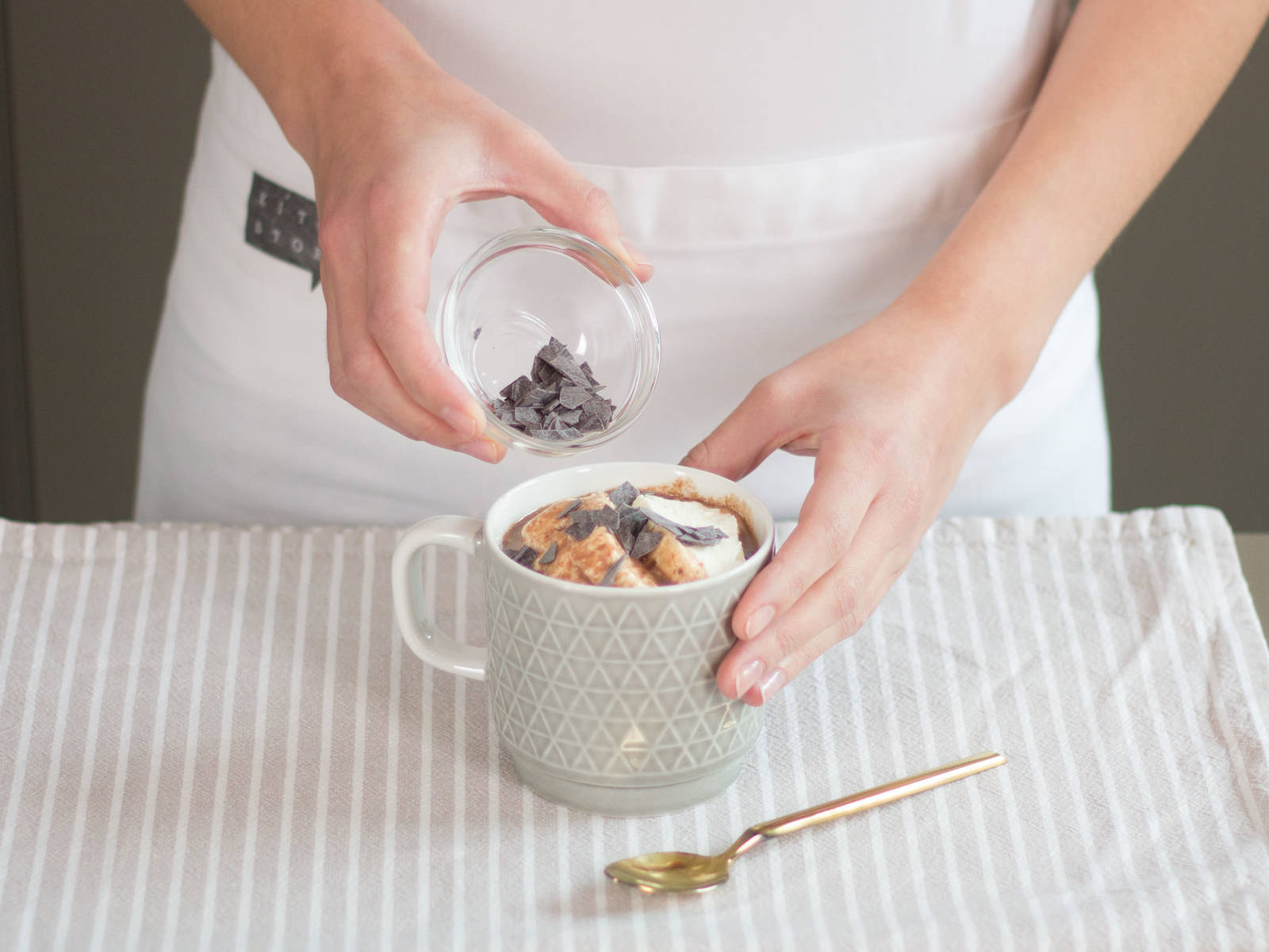 Remove star anise and cloves from hot chocolate. Pour into cups and top off with a dollop of whipped cream. Sprinkle with chocolate shavings and enjoy!